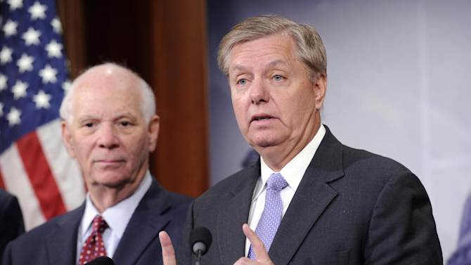 Sen. Lindsey Graham, R-S.C., right, speaks during a news conference on the violence in the Mideast on Capitol Hill in Washington, Thursday, July 24, 2014. At left is Sen. Ben Cardin, D-Md., left. (AP Photo)