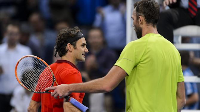 Tennis - Federer defies 33-ace Karlovic to make 11th Swiss final