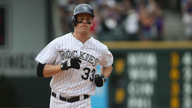 Colorado Rockies' Justin Morneau circles the bases after hitting a two-run, walkoff home run against the San Diego Padres in the 10th inning of the Rockies' 8-6 victory in 10 innings of a baseball game in Denver on Sunday, May 18, 2014