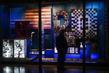 A man stands in the National September 11 Memorial & Museum during a press preview in New York