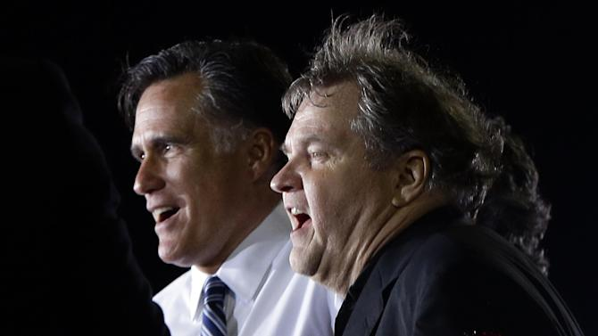 "Republican presidential candidate and former Massachusetts Gov. Mitt Romney sings ""God Bless America"" with Meat Loaf as he campaigns at the football stadium at Defiance High School in Defiance, Ohio, Thursday, Oct. 25, 2012. (AP Photo/Charles Dharapak)"