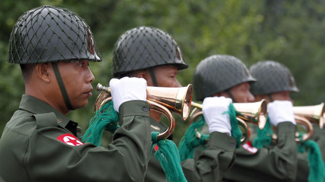 Myanmar soldiers play during a ceremony to mark the 65th anniversary of the 1947 assassination of Aung San Suu Kyi's father, Gen. Aung San, at the Martyrs' Mausoleum in Yangon, Myanmar on Thursday, July 19, 2012.  For the first time in decades, Myanmar state television broadcast the memorial ceremony for the country's independence hero, the latest sign of change in the former pariah nation. (AP Photo/Khin Maung Win)
