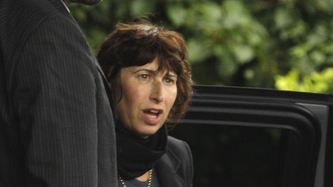 British singer Amy Winehouse's mother Janis arrives at Golders Green Crematorium in north London, Tuesday, July 26, 2011 for the funeral of her daughter Amy Winehouse, the soul diva, who had battled alcohol and drug addiction, and was found dead Saturday at her London home. She was 27. Friends and family said goodbye to Amy Winehouse Tuesday with prayers, tears, laughter and song at a funeral ceremony in London.  (AP Photo/Joel Ryan)