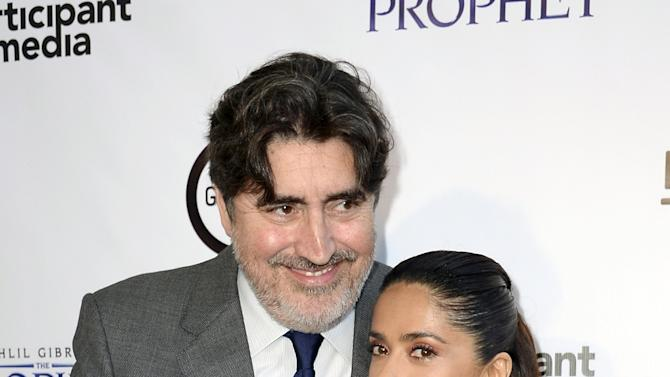 "Producer and cast member Salma Hayek-Pinault poses with fellow cast member Alfred Molina during the Los Angeles screening of Khalil Gibran's ""The Prophet"" at Los Angeles County Museum of Art's Bing Theater in Los Angeles"