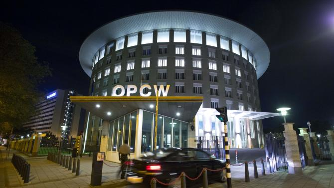 FILE - In this Friday Sept. 27, 2013 file photo a car arrives at the headquarters of the Organization for the Prohibition of Chemical Weapons, OPCW, in The Hague, Netherlands. The OPCW were awarded the Nobel Peace Prize on Friday, Oct. 11, 2013. (AP Photo/Peter Dejong, File)