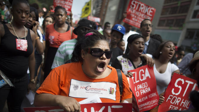 Fast-food workers in NYC stage strikes, rallies