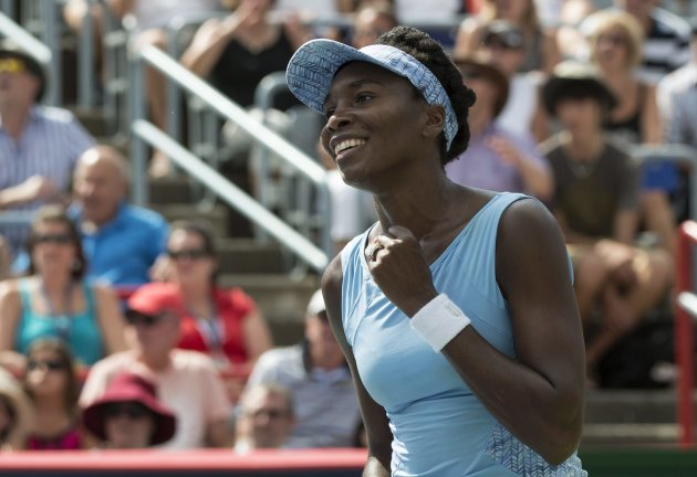 Venus Williams of the United States celebrates after beating her sister Serena 6-7, 6-2, 6-3 at the Rogers Cup Saturday. (AP Photo/The Canadian Press,...