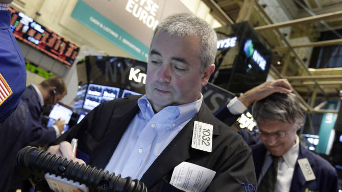 Trader Edward McCarthy, left, works on the floor of the New York Stock Exchange, Friday, June 21, 2013. U.S. stocks rose in morning trading on Friday as traders regrouped following the biggest drop of the year. (AP Photo/Richard Drew)