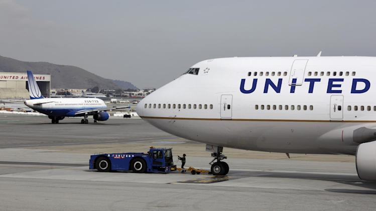 FILE - This Feb. 23, 2011 file photo shows United Airlines planes taxing at San Francisco International Airport in San Francisco. The government is moving toward easing restrictions on the use of electronic devices by airline passengers during taxiing, takeoffs and landings. An industry-labor advisory committee was expected to make recommendations next month to the Federal Aviation Administration on easing the restrictions, but the FAA said Friday that deadline has been extended to September. (AP Photo/Eric Risberg, File)