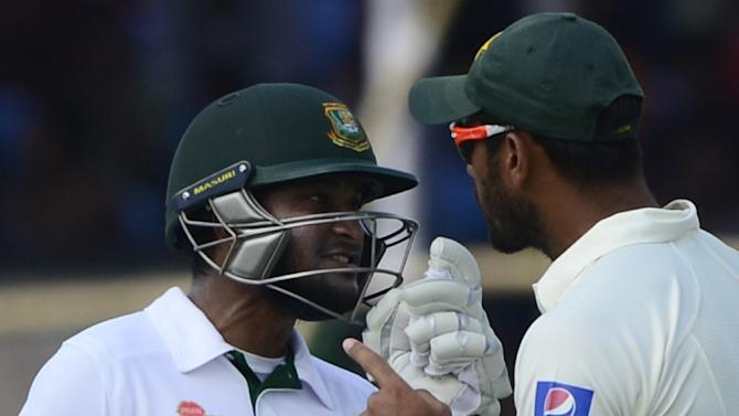 Bangladesh's Shakib Al Hasan (L) gets into an altercation with Pakistan's Wahab Riaz (R) during the fifth day of the first cricket Test at The Sheikh Abu Naser Stadium in Khulna on May 2, 2015