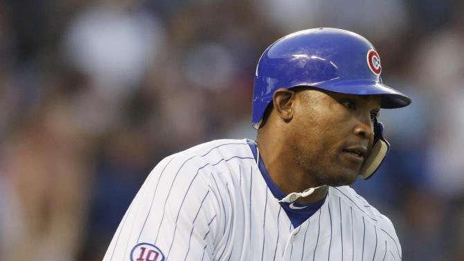 Chicago Cubs' Marlon Byrd rounds the bases after hitting a solo home run during the second inning of a baseball game against the Florida Marlins, Thursday, July 14, 2011, in Chicago. (AP Photo/Nam Y. Huh)