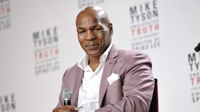 """In this June 18, 2012 file photo, former heavyweight boxer Mike Tyson announces """"Mike Tyson: Undisputed Truth"""" a one man show on Broadway, in New York. Tyson and his wife sued SFX Financial Advisory Management Services, a subsidiary of Live Nation Entertainment on Wednesday Feb. 20, 2013 claiming a former employee of the financial services company embezzled more than $300,000 from them and cost them millions in lucrative contracts.(Photo by Evan Agostini/Invision/AP, File)"""