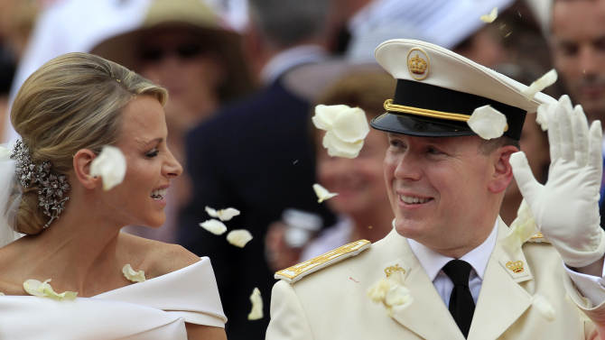 FILE - In this Saturday, July 2, 2011 file photo Prince Albert II of Monaco and Princess Charlene of Monaco depart from the Monaco palace after their religious wedding ceremony. Prince Albert of Monaco has accepted an apology and damages from Britain's Sunday Times newspaper over an article suggesting his wife Princess Charlene was reluctant to marry him. The prince's lawyer, Mark Thomson, said Tuesday Jan. 15, 2013 that the newspaper had admitted the allegations were untrue. (AP Photo/Jean Paul Pelissier, Pool, File)