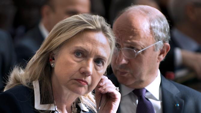 """FILE - In this July 6, 2012 file photo, U.S. Secretary of State Hillary Rodham Clinton and French Foreign Minister Laurent Fabius attend the """"Friends of Syria"""" conference in Paris. The United States is readying new sanctions on Syrian President Bashar Assad's regime and its allies as Clinton heads to Turkey on Friday, Aug. 10, 2012, for weekend talks with top Turkish officials and Syrian opposition activists. (AP Photo/Brendan Smialowski, Pool, File)"""