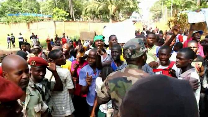 In this frame  grab taken from APTN  footage from Thursday, Dec. 27, 2012, members of the crowd shout towards soldiers, during an address by the President Francois Bozize, in Bangui, Central African Republic. The president of Central African Republic on Thursday urgently called on France and other foreign powers to help his government fend off rebels who are quickly seizing territory and approaching the capital Bangui. French officials, however, declined to offer any military assistance in response to the plea from Francois Bozize. (AP Photo)