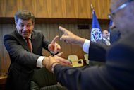 Britain's Guy Ryder (L) is congratulated by delegates after his acceptance speech at the International Labour Organization (ILO) in Geneva. ILO elected Ryder as the new head of the agency, replacing outgoing chief of 13 years Juan Somavia