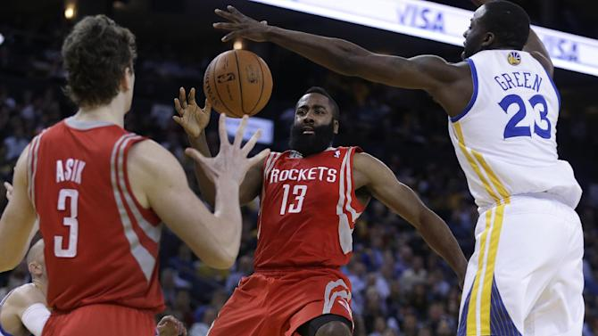 Harden injures elbow in Rockets' loss to Warriors