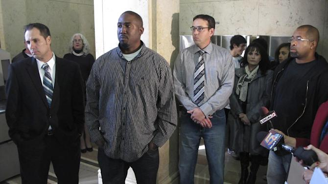 From left to right, Jim Lancaster, 46, of Alexandria, Ky. Damon Robinson, 36, of Lexington, Ky. Micah Morthland, 38, of Highland Heights, Ky. and Mark Hedges, 45, of Cincinnati, stand in the Hamilton County Court of Common Pleas, Monday, Nov. 5, 2012, in Cincinnati shortly after filing a lawsuit against builders of Cincinnati's first and only casino, slated to open in the spring. The men were injured while pouring concrete on a second floor at the casino in January and allege that the construction firms neglected safety to get the project done on time. (AP Photo/Amanda Lee Myers)