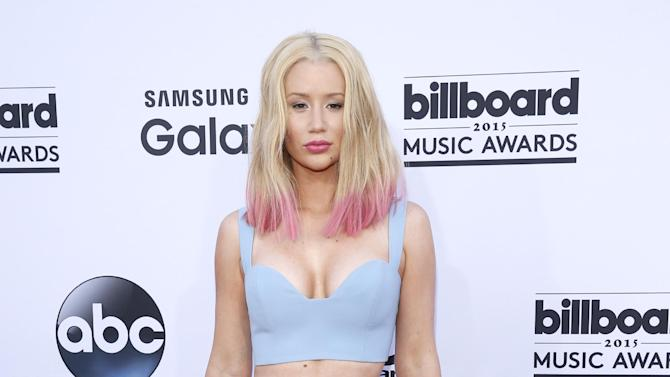"File-This May 17m 2015, file photo shows Iggy Azalea arriving at the Billboard Music Awards at the MGM Grand Garden Arena in Las Vegas. Azalea has canceled her U.S. tour for a second time. The ""Fancy"" rapper tweeted Friday ""as u may know, the tour is cancelled."" She added that she's ""so sad and sorry to let my fans down."" Azalea announced in March that The Great Escape Tour would not kick off in April. She rescheduled the tour due to production delays and said it would take place this fall. (Photo by Eric Jamison/Invision/AP, File)"