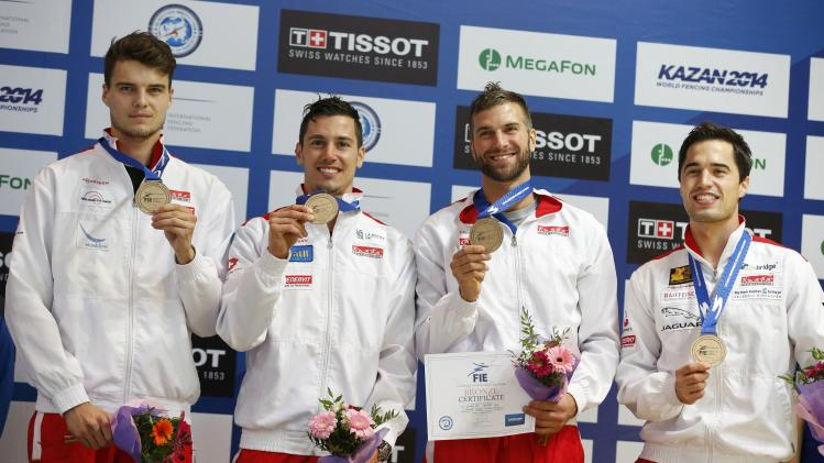 Team Switzerland pose with their in the bronze medals for the men's team epee competition at the World Fencing Championships in Kazan