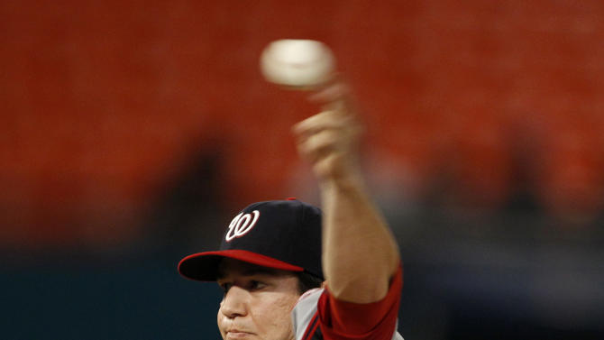 Washington Nationals starting pitcher Tom Milone (46) delivers against the Florida Marlins during the first inning a baseball game, Monday, Sept. 26, 2011, in Miami. (AP Photo/Lynne Sladky)
