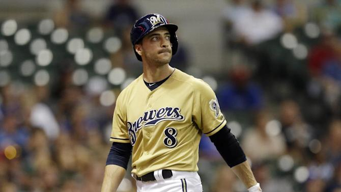 """File-Milwaukee Brewers' Ryan Braun reacts after striking out after pinch hitting during the 11th inning of a baseball game against the Miami Marlins Sunday, July 21, 2013, in Milwaukee. Braun, a former National League MVP, has been suspended without pay for the rest of the season and admitted he """"made mistakes"""" in violating Major League Baseball's drug policies. MLB Commissioner Bud Selig announced the penalty Monday and released a statement by the Milwaukee Brewers slugger, who said: """"I am not perfect. I realize now that I have made some mistakes. I am willing to accept the consequences of those actions."""" (AP Photo/Morry Gash)"""