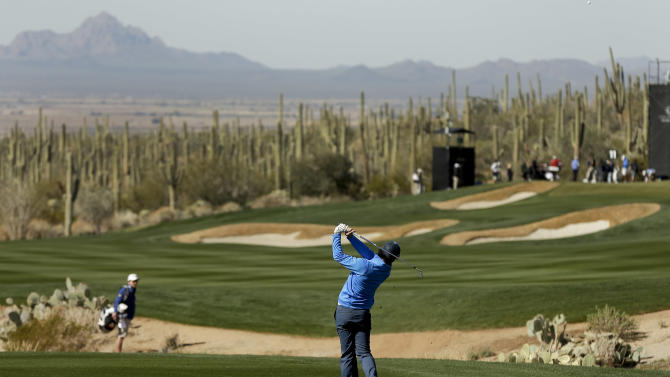Rory McIlroy of Northern Ireland hits an approach shot off the 11th fairway during a practice round for the Match Play Championship golf tournament, Tuesday, Feb. 19, 2013, in Marana, Ariz. (AP Photo/Julie Jacobson)