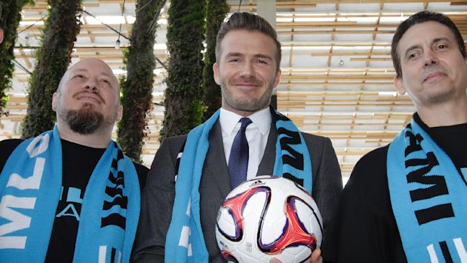 David Beckham poses with fans after holding a press conference at the Perez Art Museum Miami, in Miami, Florida on February 5, 2014