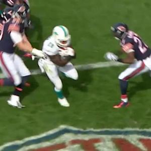 Miami Dolphins running back Lamar Miller walks in for 2-yard TD