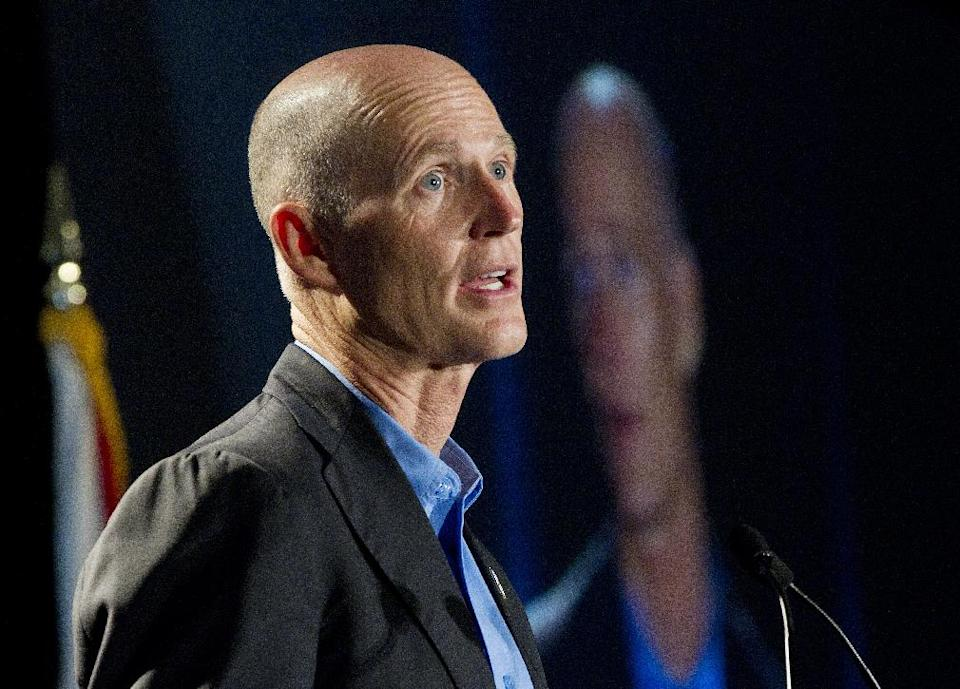 FILE - In this May 16, 2012, file photo Florida Gov. Rick Scott speaks in Fort Lauderdale, Fla. The Republican National Committee has announced that Scott will be one of the speakers at the 2012 GOP Convention in Tampa. (AP Photo/J Pat Carter, File)