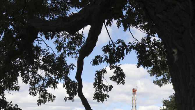 This Wednesday, Sept. 19, 2012, photo, shows a drill rig in Carrollton, Ohio. Rural Carroll County boasts more active oil and gas wells than any other county in Ohio, and the tax dollars are flowing right along with the crude. (AP Photo/Tony Dejak)