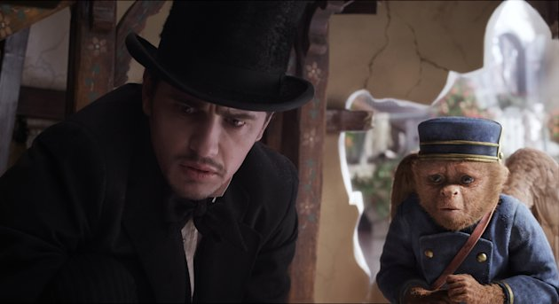 This film image released by Disney Enterprises shows James Franco, as Oz, left, and the character Finley, voiced by Zach Braff, are shown in a scene from &quot;Oz the Great and Powerful.&quot; (AP Photo/Disney Enterprises)