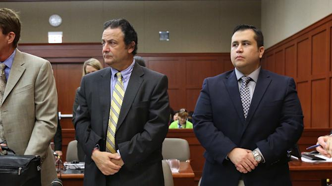 Defense attorney Mark O'Mara, left, jury consultant Robert Hirschhorn, second from left, defendant George Zimmerman and co-counsel Don West, right, stand during the arrival of a prospective juror during Zimmerman's trial in Seminole circuit court in Sanford, Fla., Tuesday, June 18, 2013. Zimmerman has been charged with second-degree murder for the 2012 shooting death of Trayvon Martin.(AP Photo/Orlando Sentinel, Joe Burbank, Pool)