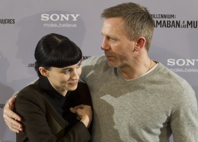 US actress Rooney Mara, left, and British actor Daniel Craig pose during a photo call to promote the Spanish release of the movie 'The Girl with the Dragon Tattoo' in Madrid, Wednesday Jan. 4, 2012. (