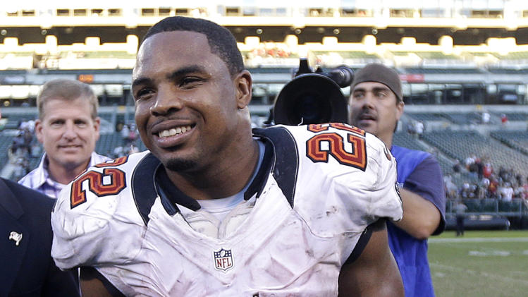 Tampa Bay Buccaneers running back Doug Martin (22) smiles as he walks off the field after an NFL football game against the Oakland Raiders in Oakland, Calif., Sunday, Nov. 4, 2012. The Buccaneers won 42-32. The rookie rushed for a franchise-record 251 yards and four touchdowns. (AP Photo/Marcio Jose Sanchez)