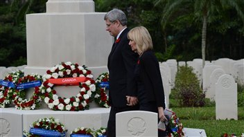 Prime Minister Stephen Harper and wife Laureen honoured the war dead in a Remembrance Day ceremony in Hong Kong on Nov. 11.
