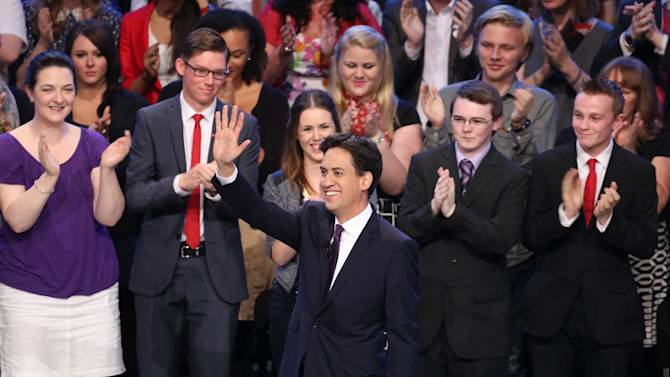 Labour leader Ed Miliband, gestures, as he makes his keynote speech to delegates, during his party's annual conference, at The Brighton Centre, Brighton, England, Tuesday Sept. 24, 2013. (AP Photo/PA, Gareth Fuller) UNITED KINGDOM OUT