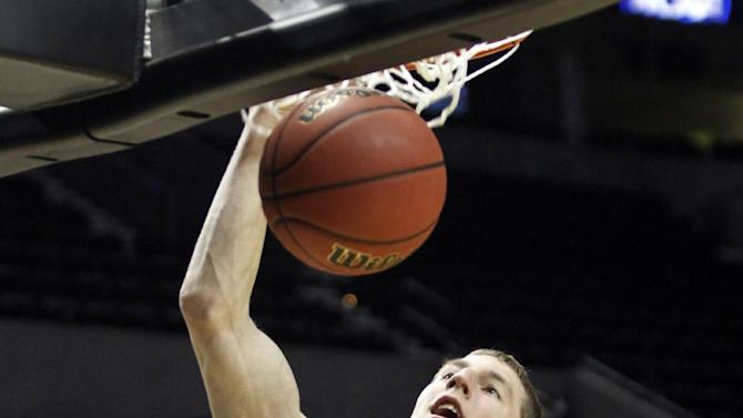 FILE - Wednesday, March 14, 2012 file photo, Indiana forward Cody Zeller dunks during practice in Portland, Ore. Zeller and Creighton junior forward Doug McDermott are the leading vote-getters on The Associated Press' preseason All-America team, announced Monday, Oct. 29, 2012. (AP Photo/Don Ryan, File)