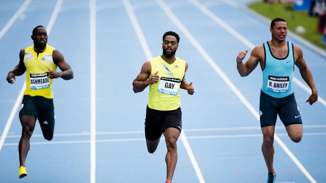 Tyson Gay, representing the USA, center, wins the Men's 100m alongside Ryan Bailey, of the USA, right, and Nickel Ashmeade, of Jamaica, left, during the IAAF Diamond League Grand Prix competition on Randall's Island, Saturday, May 25, 2013, in New York. (AP Photo/John Minchillo)