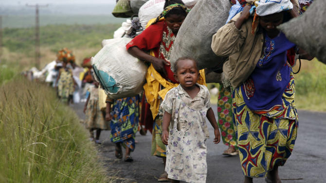 Congolese   flees the eastern Congolese town of Sake , 27kms west of Goma, Friday Nov. 23 2012.  Thousands fled the M23 controlled town  as   platoons of rebels were making their way across the hills from Sake to the next major town of Minova, where the Congolese army was believed to be regrouping. The militants seeking to overthrow the government vowed to push forward despite mounting international pressure.(AP Photo/Jerome Delay)