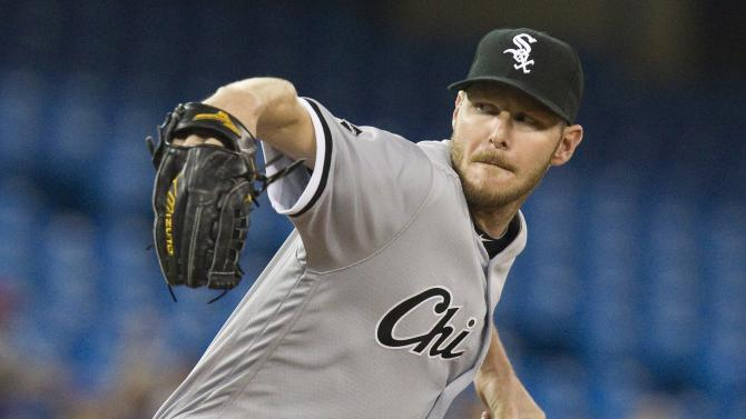 FILE - In this April 26, 2016 file photo, Chicago White Sox starting pitcher Chris Sale throws against the Toronto Blue Jays during a baseball game in Toronto. Expectations for both Chicago baseball teams this year are high as the Cubs and White Sox lead their perspective leagues three weeks into the season. (Fred Thornhill/The Canadian Press via AP, File)