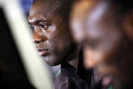 AC Milan's coach Clarence Seedorf and his player Michael Essien attend a news conference at the Vicente Calderon stadium in Madrid
