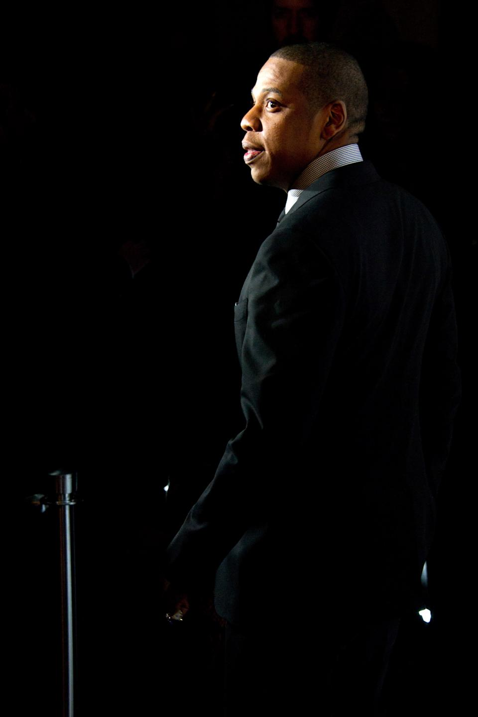 FILE - In this Jan. 19, 2012 file photo, Jay-Z attends the grand re-opening of his 40/40 Club, in New York. Jay-Z will kick off the South By Southwest festival with a performance on Monday, March 12, in Austin, Texas.  (AP Photo/Charles Sykes, file)