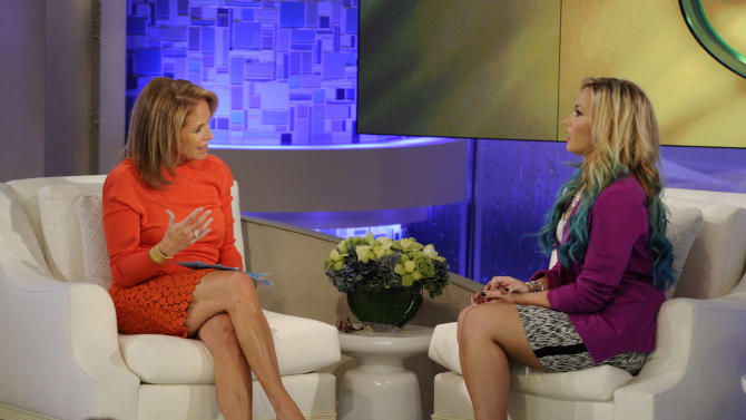 """This undated photo released by ABC shows host Katie Couric, left, with actress-singer and judge on the singing competition series """"The X Factor,"""" Demi Lovato during the taping of an appearance on """"Katie,"""" in New York.  The interview will air on Monday, Sept. 24. (AP Photo/Disney-ABC Domestic Television, Ida Mae Astute)"""