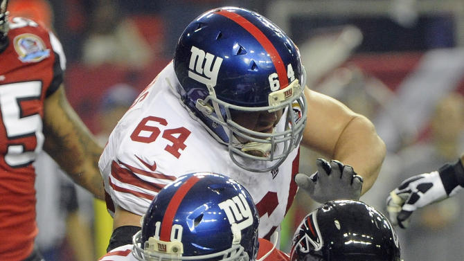 Atlanta Falcons defensive end Kroy Biermann, sacks New York Giants quarterback Eli Manning (10) during the first half of an NFL football game, Sunday, Dec. 16, 2012, in Atlanta. (AP Photo/John Amis)