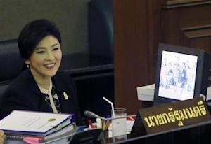 Thailand's Prime Minister Yingluck Shinawatra smiles during a debate by the opposition in parliament in Bangkok November 26, 2013.