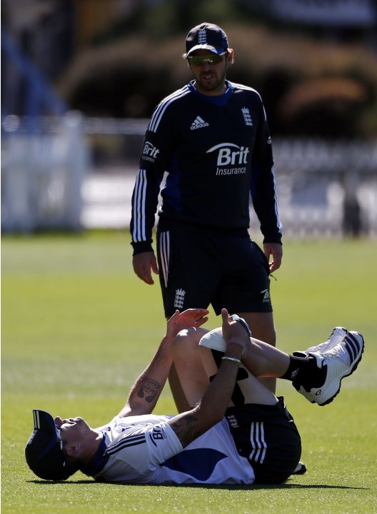 England cricket team player Pietersen stretches with his knee strapped during a team training session in Wellington