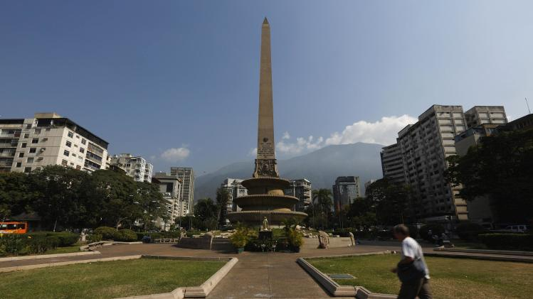 Man walks at Altamira square in Caracas