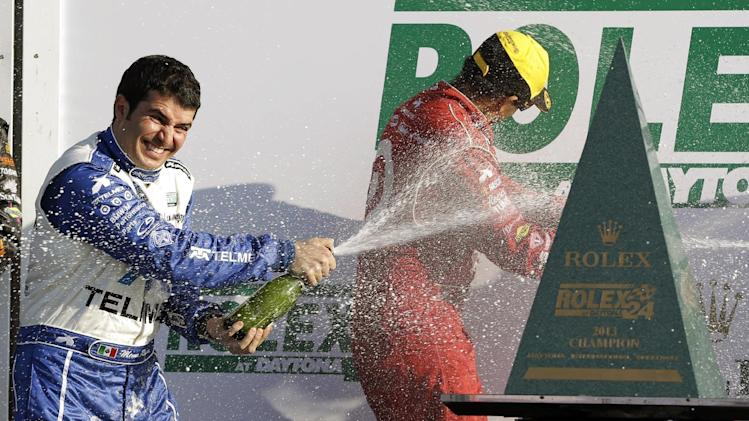 Memo Rojas, left, of Mexico, douses teammate Juan Pablo Montoya, of Colombia, after winning the Grand-Am Series Rolex 24 hour auto race at Daytona International Speedway, Sunday, Jan. 27, 2013, in Daytona Beach, Fla. (AP Photo/John Raoux)