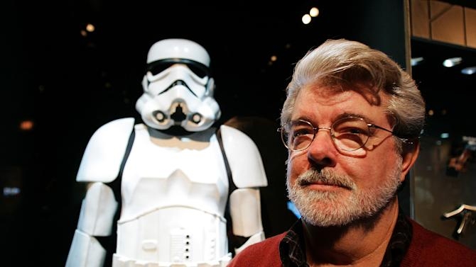 "FILE - In this Oct. 22, 2005 file photo, filmmaker George Lucas poses in front of a Stormtrooper exhibit at the Museum of Science in Boston, prior to the opening of ""Star Wars: Where Science Meets Imagination,"". Britain's Supreme Court on Wednesday, July 27, 2011 delivered a mixed ruling in the epic battle between George Lucas' movie empire and a prop designer over the iconic stormtrooper helmets from the ""Star Wars"" films. Lucasfilm Ltd. has been trying to stop Andrew Ainsworth from selling replica costumes over the Internet. Ainsworth sculpted the galactic warriors' white helmets for the original ""Star Wars"" film in 1977. (AP Photo/Winslow Townson, File)"
